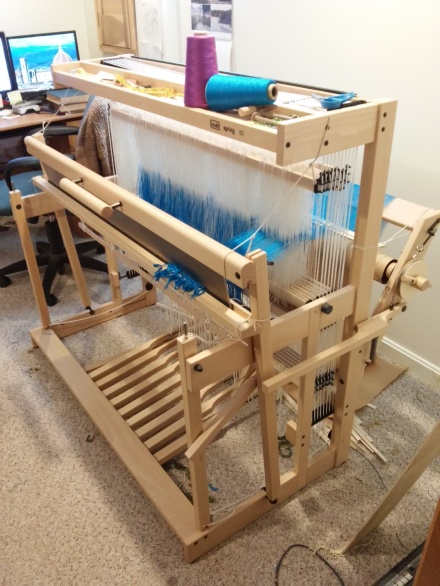 The Spring loom minus its front beam, showing the warping in progress.